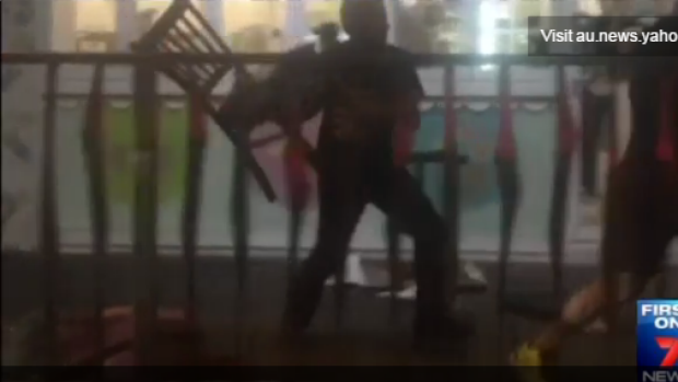 Men used chair to beat each other outside an ice cream parlour in Brighton-Le-Sands.