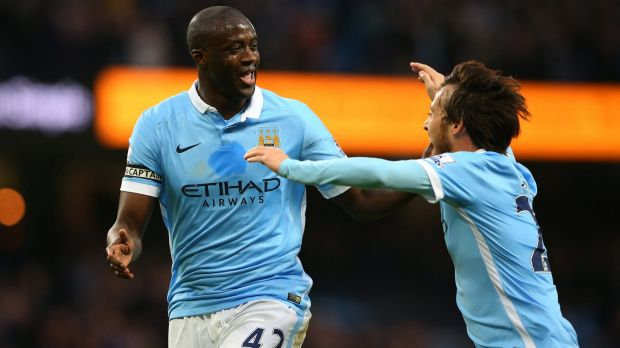 Yaya Toure of Manchester City (left) is reported to have been offered staggering sums to play in China.
