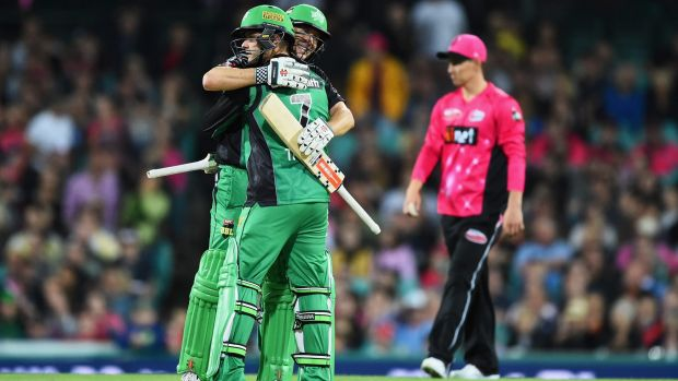 Runs on the board: David Hussey and Tom Triffitt celebrate the Stars' first win of the season.