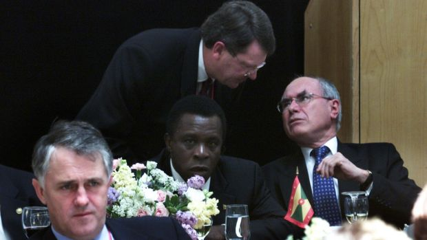 In this 2002 file photo, Lynton Crosby speaks with John Howard, with Malcolm Turnbull in the foreground.