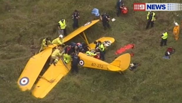 Emergency services work to free a person trapped in the wreckage of a light plane crash on the Gold Coast.