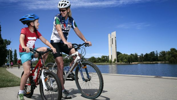 Max Millgate, 8, of Hughes, enjoys a ride around Lake Burley Griffin with his mother Sally Clark.