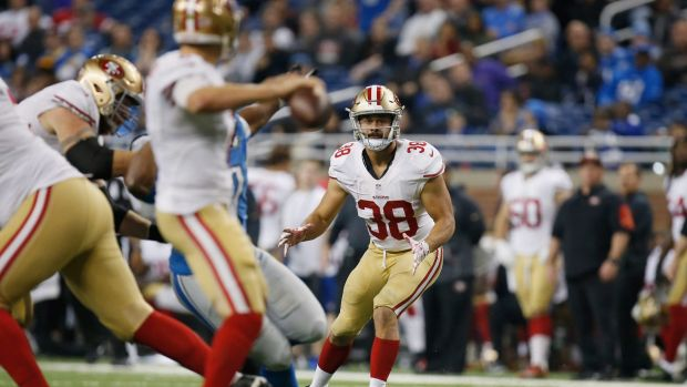 Backed: Jarryd Hayne looks for a pass from quarterback Blaine Gabbert against the Lions.
