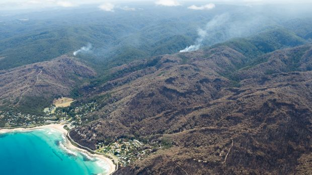 Fires still burn in the hills above Wye River and could cause difficulty for firefighters as the weather worsens later ...