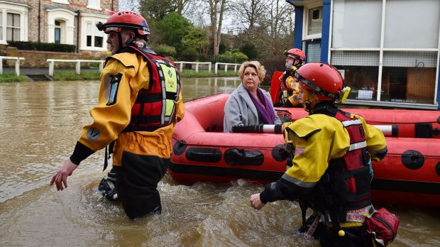 Rescue teams evacuate residents the UK city of York - with more flooding possible this week.