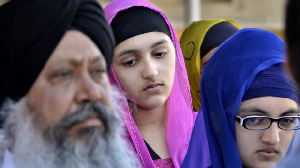 Members of the Sikh community gather for a news conference at the Sikh Association of Fresno Temple in California in ...