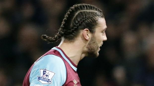 Interesting to say the least: West Ham striker Andy Carroll turned heads with his platted hairstyle.