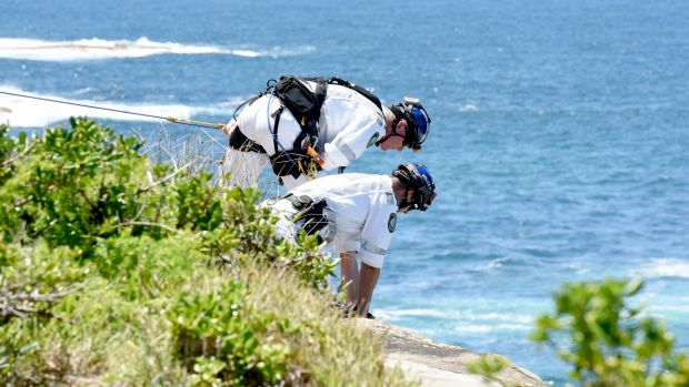 Police rescue officers on the clifftop at Coogee.
