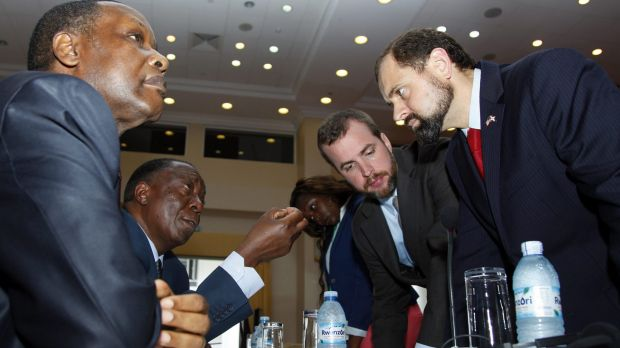 Former Burundian presidents Pierre Buyoya, left, and Sylvestre Ntibantunganya with US special envoy Tom Perriello, ...