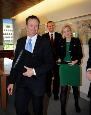 Shane Rattenbury after signing the power-sharing agreement in 2012, with Andrew Barr and Katy Gallagher in the background.