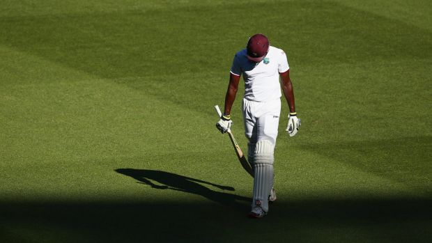 Stoic: Jason Holder trudges off after a fighting half-century.