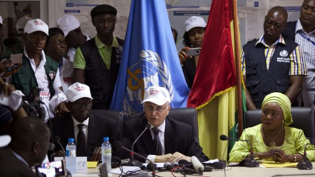 Mohamed Belhocine, centre,  a representative of the World Health Organisation, at a press briefing in Conakry, Guinea, ...