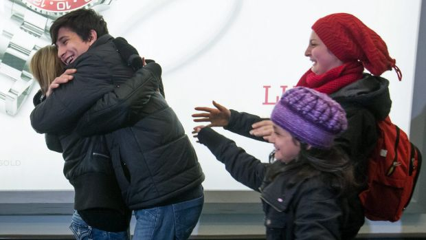 Shergo Kurdi hugs his aunt, Tima Kurdi, as his sisters, Ranim Kurdi, front right, and Haveen Kurdi, run to meet her as ...