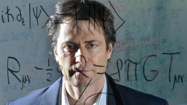 Max Tegmark, a Physics professor at MIT, stands behind the Schršdinger equation for quantum mechanics (top) and ...