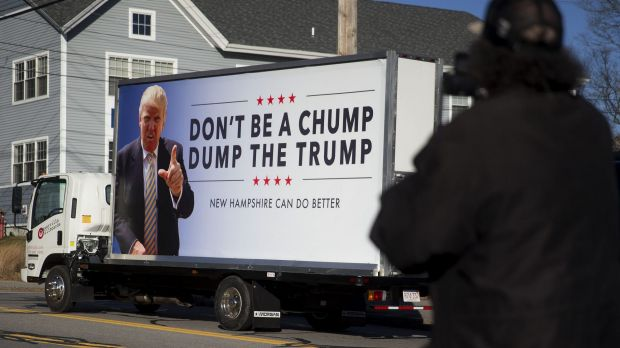 A truck with a sign against Donald Trump drives away outside a campaign stop by New Jersey Governor Chris Christie, who ...