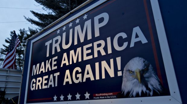 A campaign sign for Donald Trump is displayed on a trailer in Nashua, New Hampshire.
