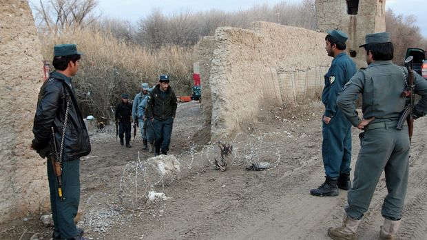 Afghan police in Lashkar Gah, capital of Helmand province, Afghanistan. Afghan police are refusing to go back on the ...