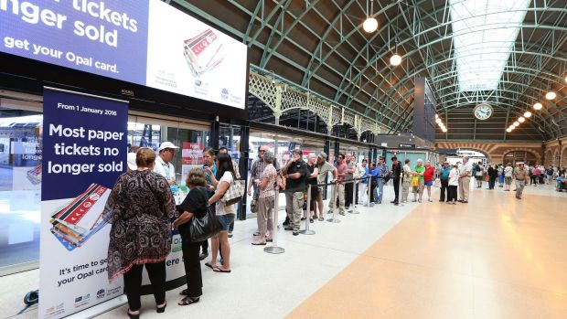 Commuters queue to buy Opal cards as paper tickets are phased out.
