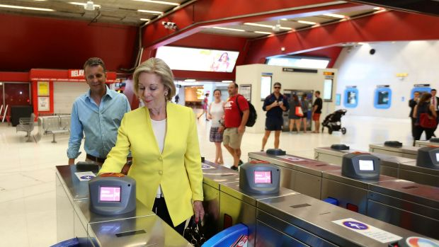 Ita Buttrose and Andrew Constance use their Opal cards at Martin Place in Sydney.