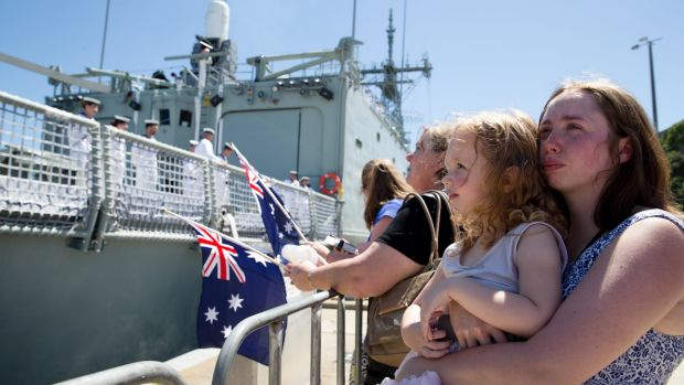 Families watch as the crew of HMAS Darwin departs for a tour of duty in the Gulf.