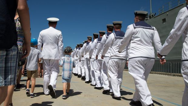 Commander Phillip Henry's family escort him to the gangway before he leaves for the seven-month tour on HMAS Darwin.