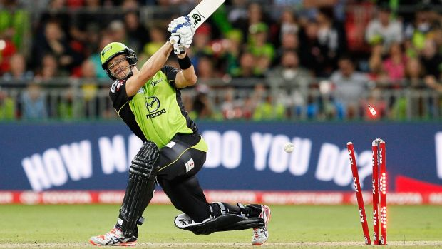 Shane Watson of the Thunder is bowled by Ben Laughlin of the Strikers.