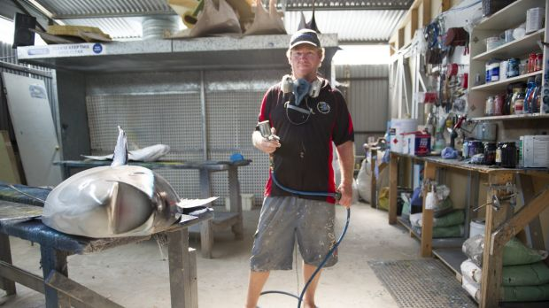 Scott Mann of Batemans Bay crafts fibreglass fish created from moulds of prize catches.
