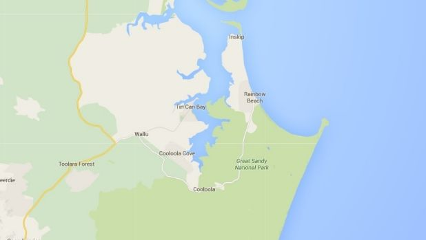 A man has died after the tinny he was in capsized off Rainbow Beach.