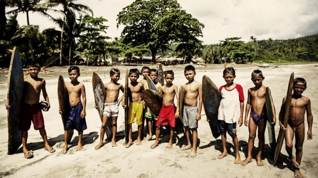 Child surfers on Morotai Island. One of Indonesia's northernmost islands, Morotai boasts a unique surfing culture.