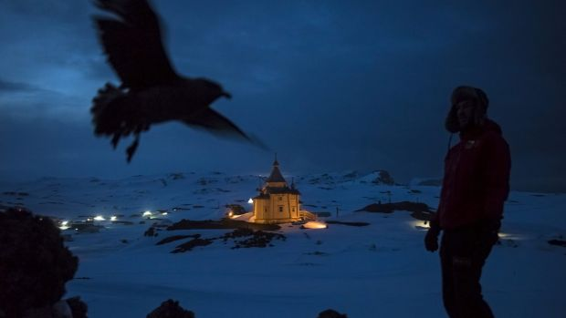 Chilean scientist Ernesto Molina near the Russian Orthodox Church of the Holy Trinity on King George Island, Antarctica.