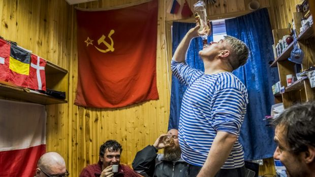 Chilean scientist Ernesto Molina (right) and Russian researchers drink homemade vodka at the Bellingshausen Antarctic base.