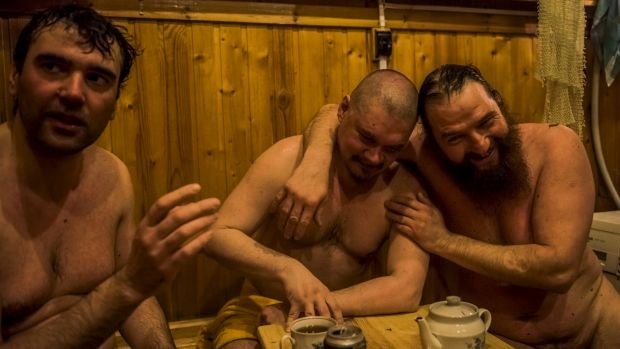 Russian winter expedition crew in the banya, or sauna, at the Bellingshausen Antarctica base.