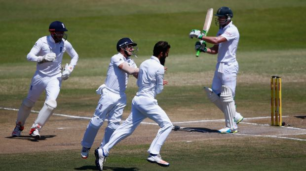 Moeen Ali of England celebrates after dismising A.B. de Villiers of South Africa soon after play began on the final day ...
