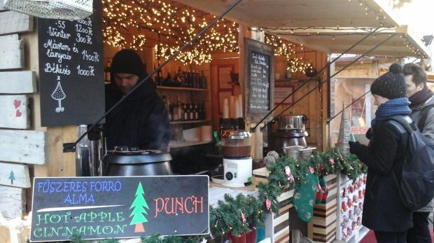 Everyone is welcome at the mulled wine stall at a Christmas and New Year market in Budapest.