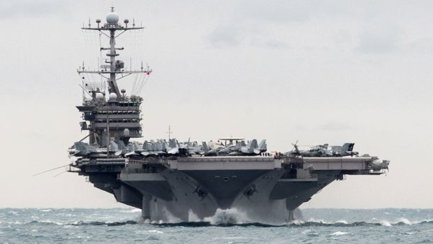 Aircraft carrier USS Harry S. Truman transits the Strait of Hormuz on Boxing Day.