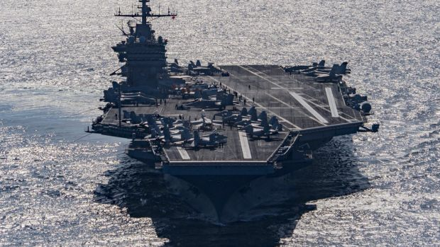 Aircraft carrier USS Harry S Truman navigates the Gulf of Oman on Christmas Day.