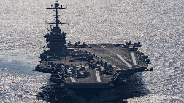 Aircraft carrier USS Harry S Truman navigates the Gulf of Oman on Christmas Day. The US Navy is being asked to tread a ...