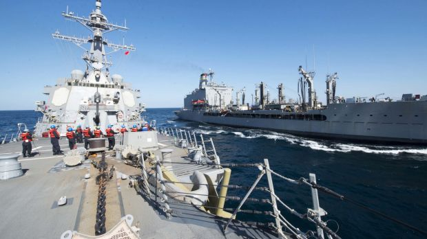 Guided-missile destroyer USS Bulkeley participates in a replenishment-at-sea with fleet replenishment oiler USNS John ...