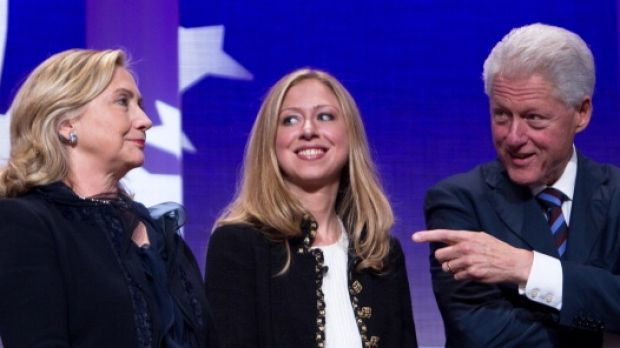 Former US president Bill Clinton on stage with his wife Hillary Rodham Clinton, former US Secretary of State, and their ...