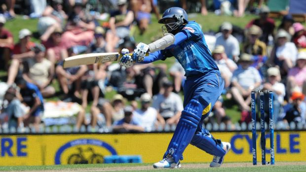 Sri Lanka's Tillakaratne Dilshan swings a ball to the boundary during his knock of 91.