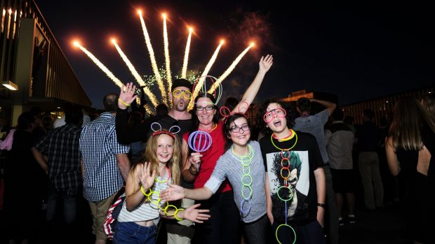 Celebrating New Years Eve at Civic Square in Canberra are from left, Yasmine Newitt,11 of Holt, Peter Vast of Holt, ...