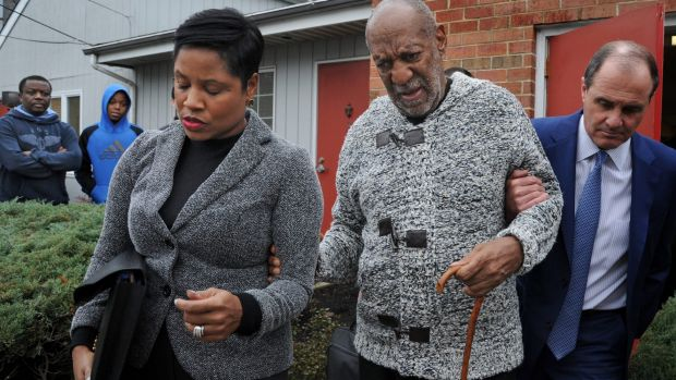 Actor and comedian Bill Cosby leaves court on Wednesday.