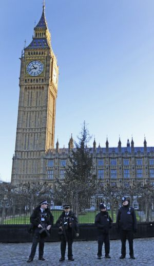 Armed police near London's Big Ben on New Year's Eve.