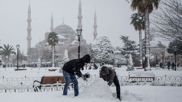 A New Year's Eve snowman is built in front of the Blue Mosque in Istanbul.