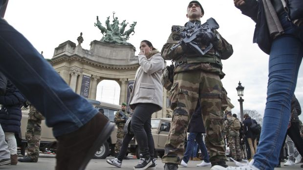 A French foreign legionnaire patrols outside the Grand Palais museum near the Champs-Élysées  in Paris.