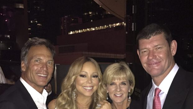 Mariah Carey and James Packer pose with David Panton and Julie Bishop on New Year's Eve.