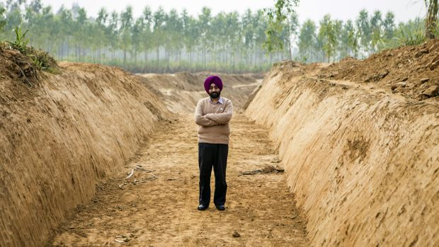 Gagandeep Singh, a development officer for Yamuna Nagar district, stands for a photograph at the site of a newly-dug ...