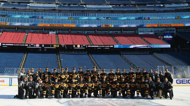 The Boston Bruins pose for a team photo prior to practice at Gillette Stadium ahead of the Winter Classic.