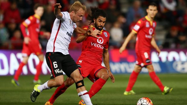 Osama Malik of Adelaide United (right) tangles with Mitch Nichols, but may be heading to Melbourne City.