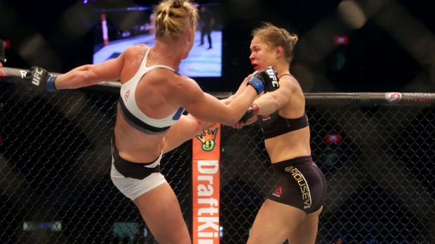 Too good: Holly Holm aims a kick at Ronda Rousey in Melbourne in November.